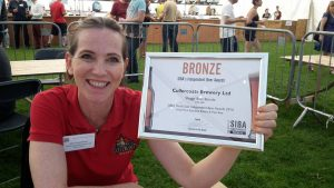 Ana from Cullercoats Brewery Ltd winning one of many SIBA awards.
