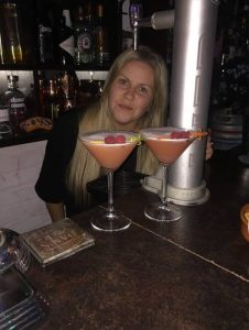 Our Development Executive enjoying cocktails in her bar the Twist Arms.