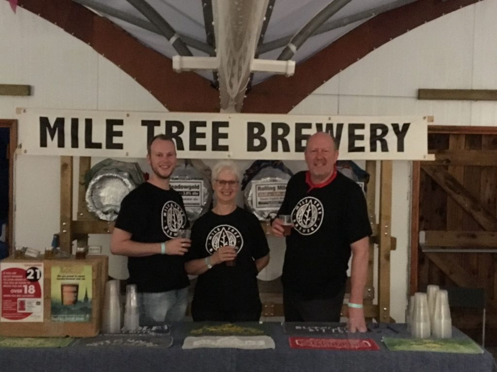 The Mile Tree Brewery team at Peterborough with brews. Spotlight of the Month interview with Brewcover UK.